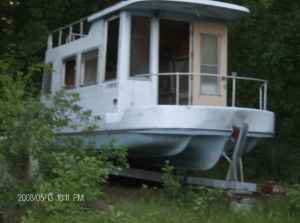 Any ideas as to who built these trailerable houseboats?