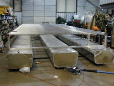 Aluminum pontoons, and the houseboat superstructure framing.