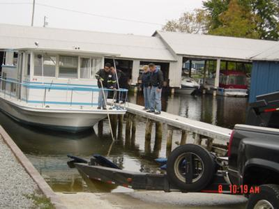 Houseboat coming out of the water for the winter.