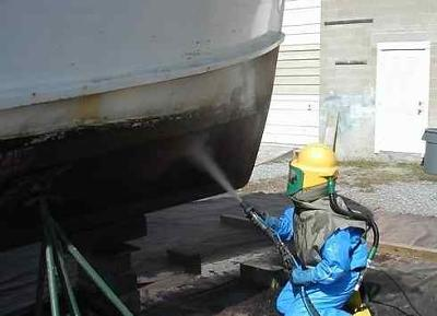 Sandblasting Houseboat Bottoms at 4 Corners Marine