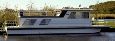 Fixing repairing fiberglass decks on Gibson houseboats.