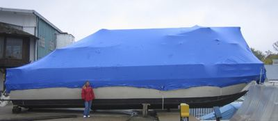 A shrink wrapped houseboat, ready for the winter storage season.