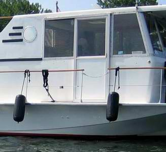 A typical houseboat door, on an exterior sliding track.