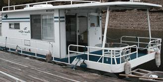 A typical older Steel Hull Sumerset Houseboat