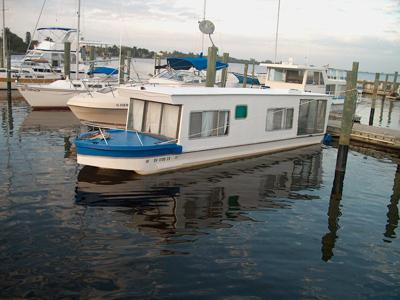 Towing a large trailerable towable houseboat.