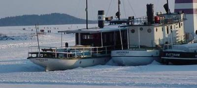 Winter Houseboat Water - boats freezing in frozen lakes.