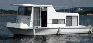 A clean looking Fisher Craft houseboat.