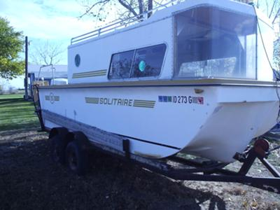 Our 1973, 20 foot, trailerable Solitaire houseboat.