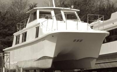 A catamaran Carri-Craft houseboat is a unique design.
