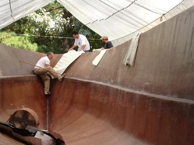 Catamaran Houseboat - building up the hull lamination
