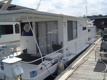 Do you repair or replace a leaking houseboat roof.