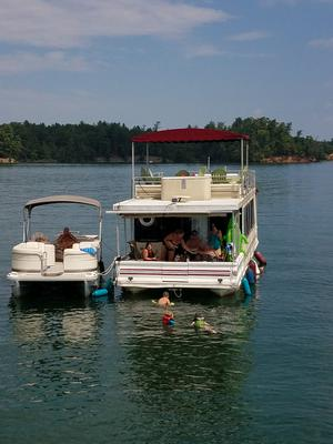 Who, and what can it cost to inspect this houseboat?