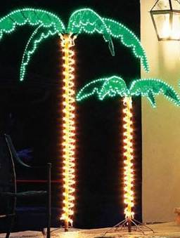 Decorative lighting and palm trees on houseboats