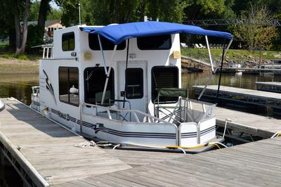 Bow view of a trailerable Nomad houseboat