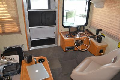 Interior helm view of Nomad houseboat