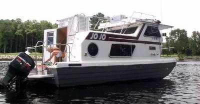 A clean rebuilt Steury Houseboat