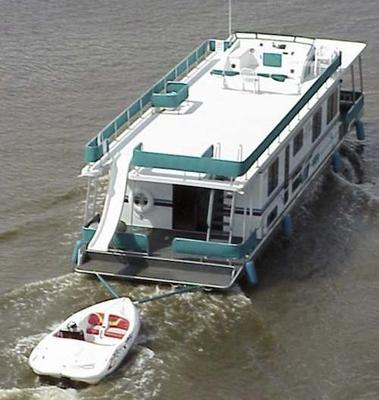 Houseboats can tow Jet-Ski's, PWC, Day Boats, Pontoons, etc...
