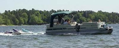 Your houseboat can tow 1, 2, 3, or 4 pwc, jet-ski's easily.